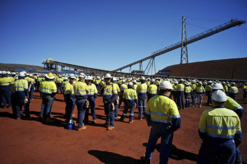 Workers at the opening of Fortescue Metals Group's Firetail iron ore mine, part of a wider $3.2 billion development, in Western Australia's Pilbara region, Monday, May 6, 2013. The company has described the opening of the mine at Solomon, 60km north of Tom Price, as one of the most important milestones in its 10-year history. (AAP Image/Tony McDonough) NO ARCHIVING, EDITORIAL USE ONLY